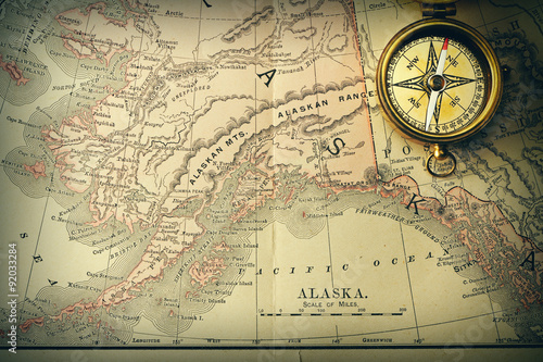 Photo  Antique compass over old XIX century map