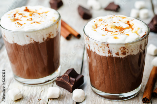 Staande foto Chocolade hot dark chocolate with whipped cream, cinnamon and salted caram