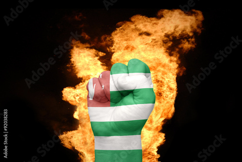 Photo fire fist with the national flag of abkhazia