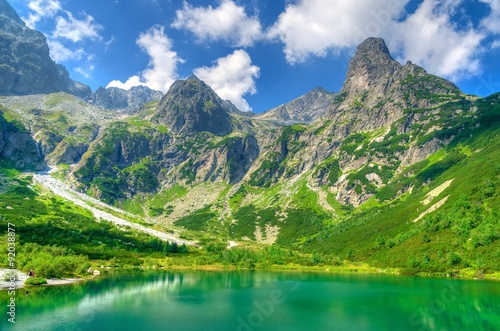 plakat Summer landscape. Lake in mountains. Zelene Pleso lake and summits in High Tatra Mountains, Slovakia.