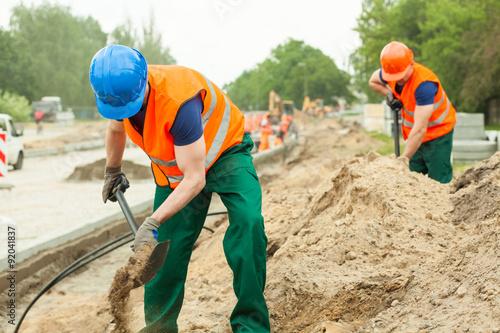 Fotografie, Obraz  Construction workers digging