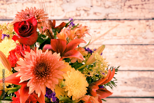 Foto op Canvas Bloemen Floral bouquet against wood background with copy space