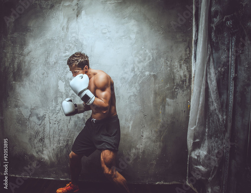Shirtless muscular fighter in action. Poster Mural XXL