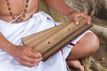 A Young Indian Man Reads An An...