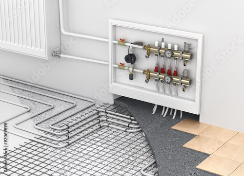 Fototapeta Underfloor heating with collector and radiator in the room. Conc obraz