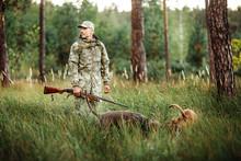 Yang Hunter With Rifle And Dog...