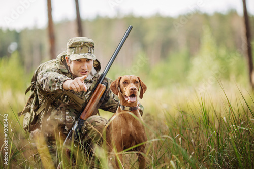 Aluminium Prints Hunting hunter with a dog on the forest