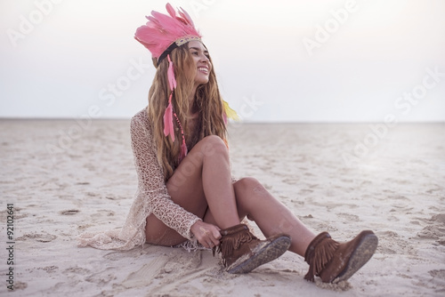 Fotografering  Beautiful young stylish women with dreadlocks and feather hat