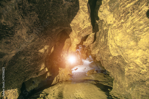 Poster Olive rock cave with sunlight