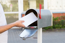 Person Putting Letters In Mail...