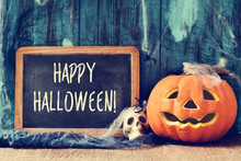 Skull, Jack-o-lantern And Text Happy Halloween In A Chalkboard