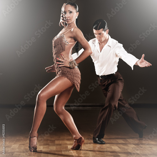 Foto op Aluminium Dance School latino dance couple in action - dancing wild samba in a ballroom with light sparcles