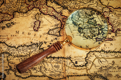 Fotografie, Obraz  Old vintage magnifying glass on ancient map