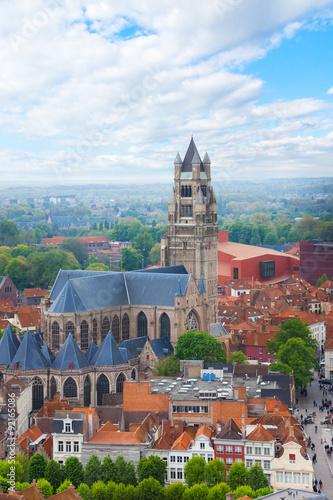 Wall Murals Bridges Cathedrale saint Sauveur in the Bruges cityscape