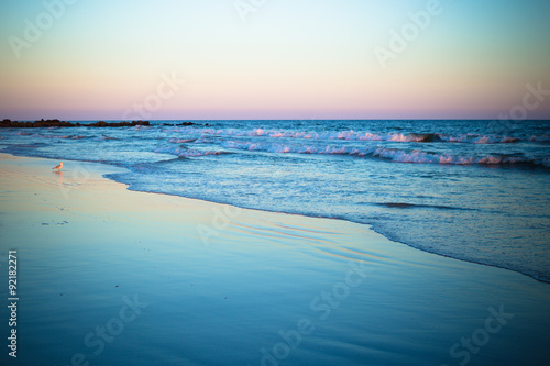 Beautiful ocean shoreline at beach at sunset Wallpaper Mural