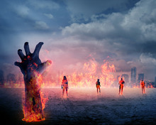 Zombie Hand With Fire Rising From The Ground