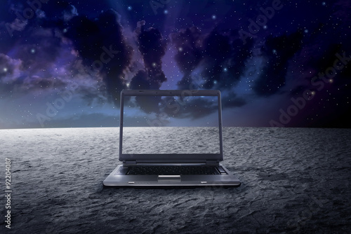 Fotografie, Tablou  Big laptop on the outer space