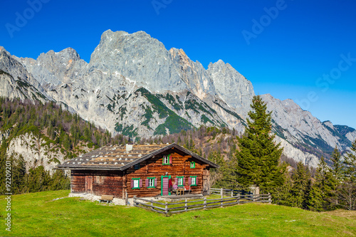 Deurstickers Landschappen Traditional mountain chalet in the Alps in autumn