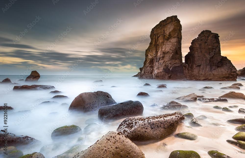 Fototapeta Golden sunset on a beautiful deserted beach