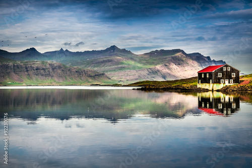 Poster Bleu nuit Small house on river bank in Iceland