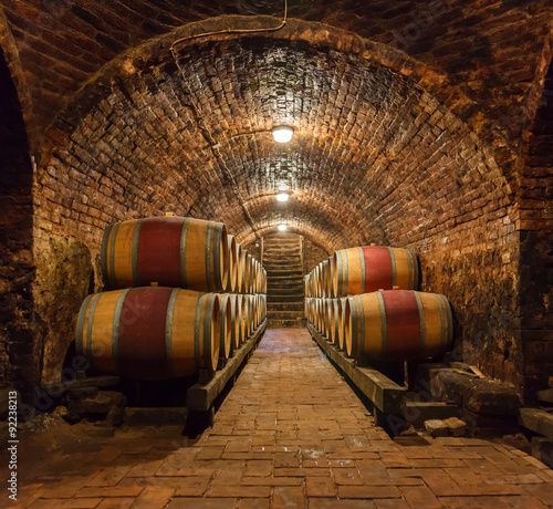Oak barrels in a underground wine cellar Wallpaper Mural