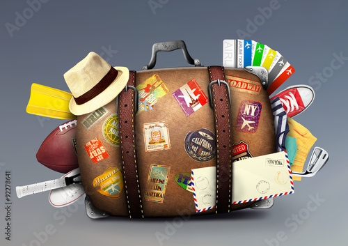 Fotografia  Full suitcase of a traveler with travel stickers