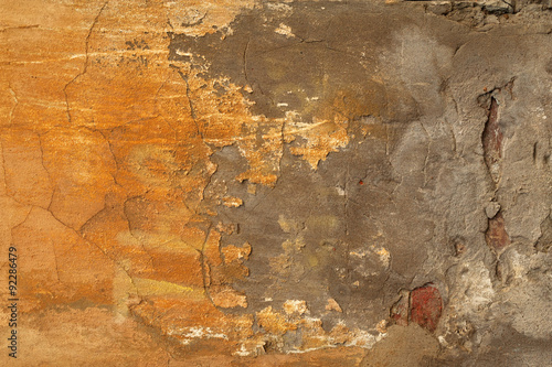 Fotoposter Oude vuile getextureerde muur Texture of old wall covered with yellow stucco