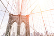 artistic view of the famous Brooklyin bridge in New York. Image taken on the upper part, with buildings skyline behind. concept about New york and traveling
