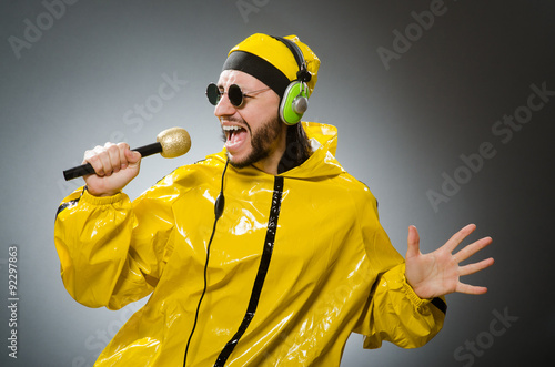 Fotografie, Obraz  Man wearing yellow suit with mic