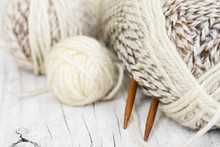 Skeins Of Wool Yarn And Knitti...