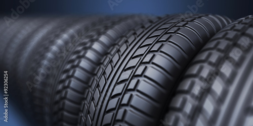 Fotografiet  Row of rubber tire 3D, on blue background