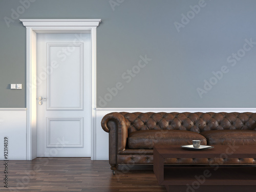 Fotografía  Door with sofa in empty room interior scene