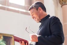 Catholic Priest Reading Bible ...