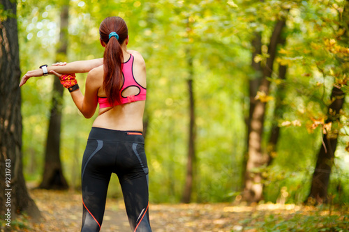 woman runner stretching before her workout Fototapeta