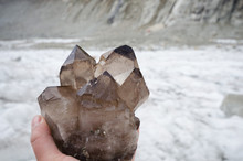Cristalllier Holding Smoky Quartz Crystals