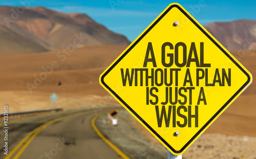 Photo  A Goal Without a Plan Is Just a Wish sign on desert road