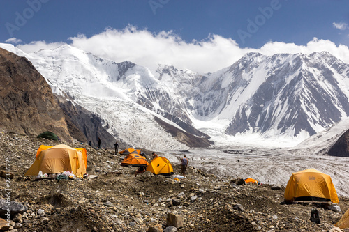 Fotografia  Base Camp of High Altitude Expedition Many Orange Tents Located on Side Rock Mor