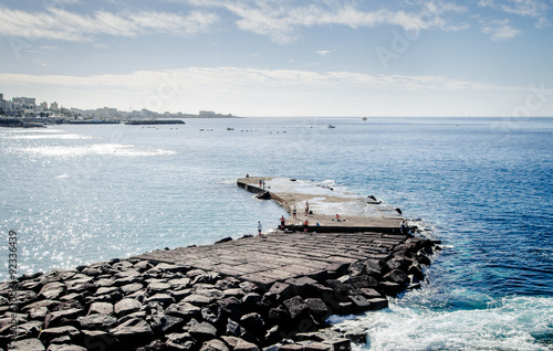 Tuinposter Canarische Eilanden Peoples fishing on the Las Americas pier. Tenerife, Canary Islands