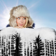 Woman with winter tyre