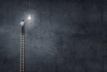 Businessman On Ladder