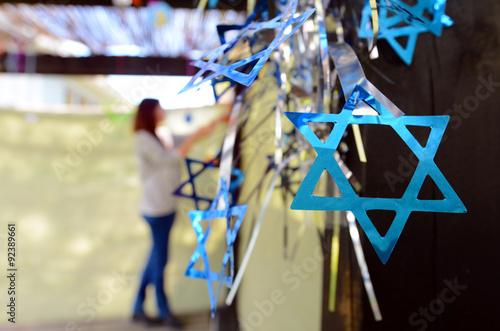 Jewish woman decorating here family Sukkah Fototapet