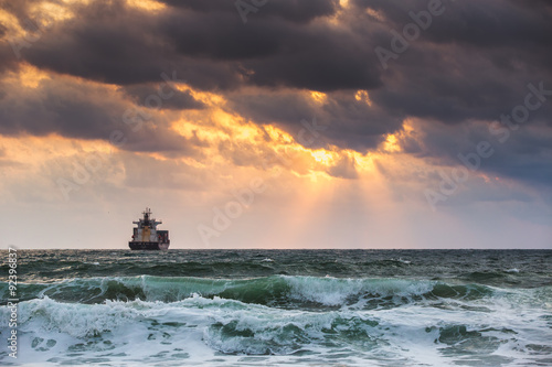 Fototapety, obrazy: Cargo ship with containers in sunrise light