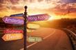 Leinwandbild Motiv fantastic sunset and Directional Signs