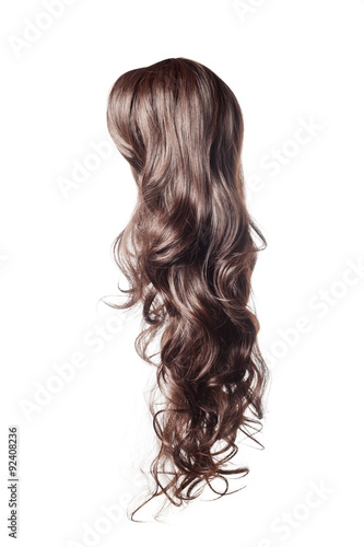 Foto long curly gray wig on a white background