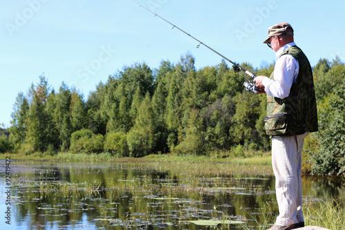 Fotobehang Vissen spinning fisherman lake landscape
