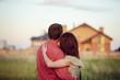 Leinwanddruck Bild - loving couple looking at their home