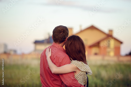 Fotografia, Obraz  loving couple looking at their home