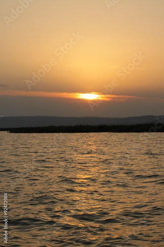 Photo  am Horizont die Sonne
