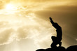 canvas print picture - praying man on beautiful sky background