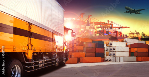 Fotografía  container truck in shipping port ,container dock and freight car